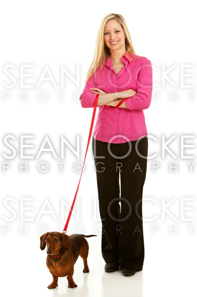 Veterinarian: Pet Owner with Dacshund Stock Photography Content by Sean Locke