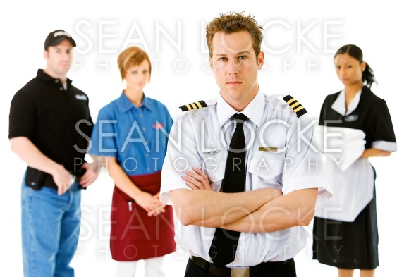 Occupations: Airline Pilot Leads Serious Group Stock Photography Content by Sean Locke
