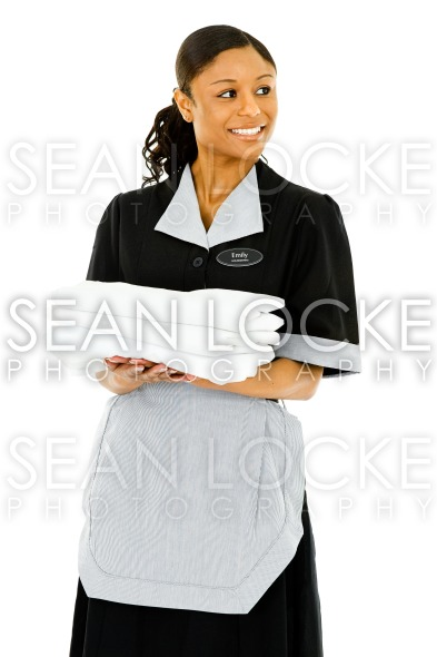 Occupations: Housekeeper Looks to Side Stock Photography Content by Sean Locke