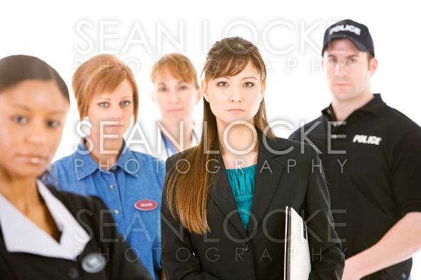 Occupations: Serious Businesswoman Leads Group Stock Photography Content by Sean Locke