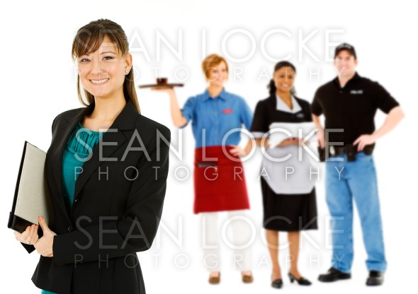 Occupations: Confident Businesswoman Leads Group Stock Photography Content by Sean Locke