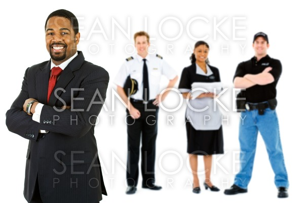 Occupations: Businessman Stands at the Front of Employee Group Stock Photography Content by Sean Locke