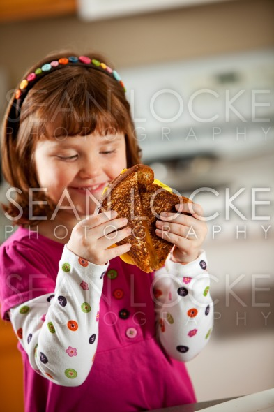 Kitchen Girl: Ready to Eat Grilled Cheese Stock Photography Content by Sean Locke