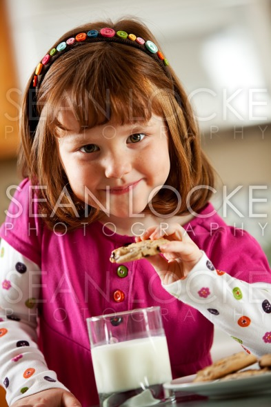 Kitchen Girl: Eating a Dunked Cookie Stock Photography Content by Sean Locke
