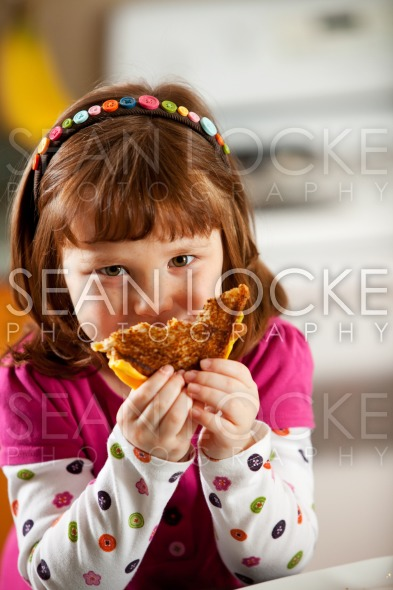 Kitchen Girl: Hungry For Grilled Cheese Stock Photography Content by Sean Locke