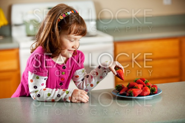 Kitchen Girl: Taking a Strawberry Stock Photography Content by Sean Locke