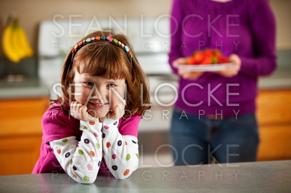 Kitchen Girl:  Waiting for Fruit Snack Stock Photography Content by Sean Locke