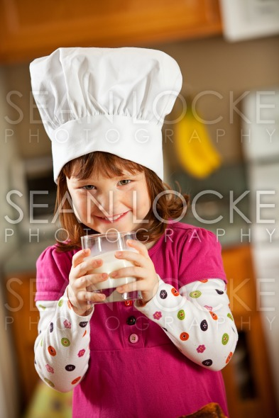 Kitchen Girl: Kid Chef Drinking Milk Stock Photography Content by Sean Locke