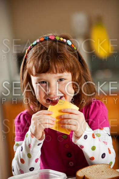 Kitchen Girl: Eating American Cheese Stock Photography Content by Sean Locke