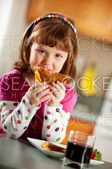 Kitchen Girl: Having Healthy Lunch Stock Photography Content by Sean Locke