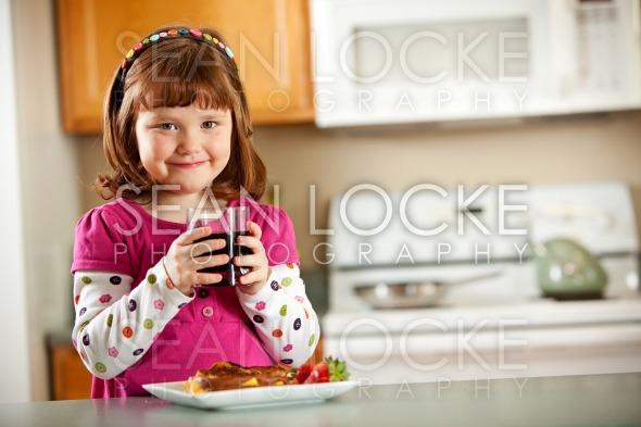 Kitchen Girl: Having Juice with Lunch Stock Photography Content by Sean Locke