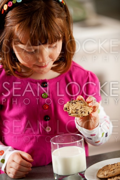 Kitchen Girl: Dunking Cookie in Milk Stock Photography Content by Sean Locke