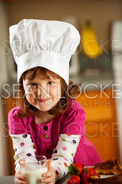 Kitchen Girl: Child Chef with Lunch Stock Photography Content by Sean Locke