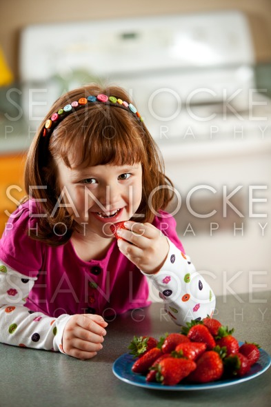 Kitchen Girl: Hungry for Strawberries Stock Photography Content by Sean Locke
