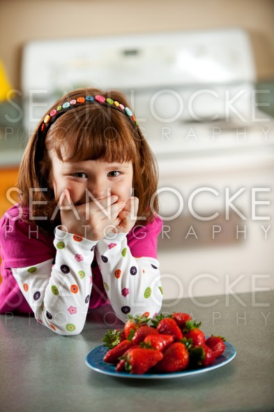 Kitchen Girl: Giggling Little Girl Stock Photography Content by Sean Locke