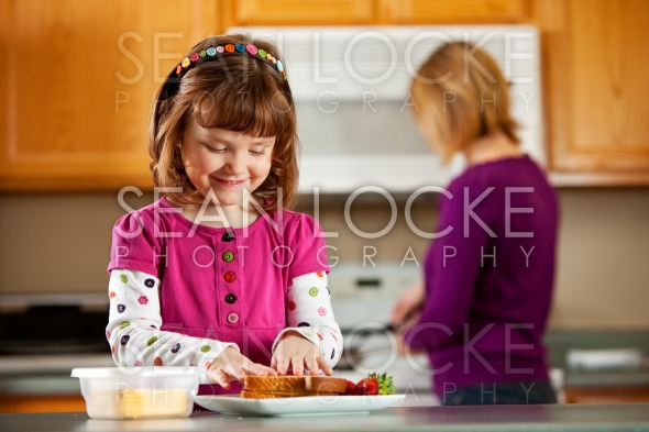 Kitchen Girl: Making a Cheese Sandwich Stock Photography Content by Sean Locke