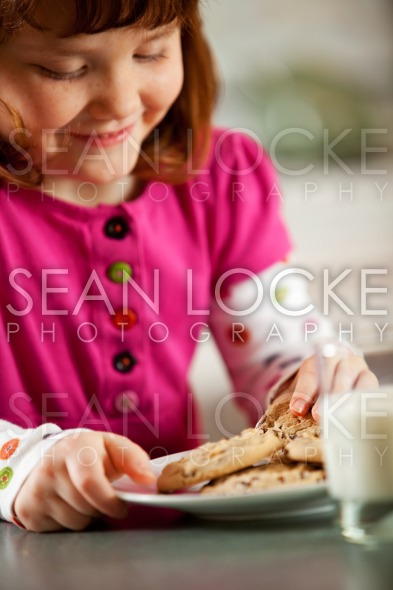 Kitchen Girl: Eating Milk and Cookies Stock Photography Content by Sean Locke