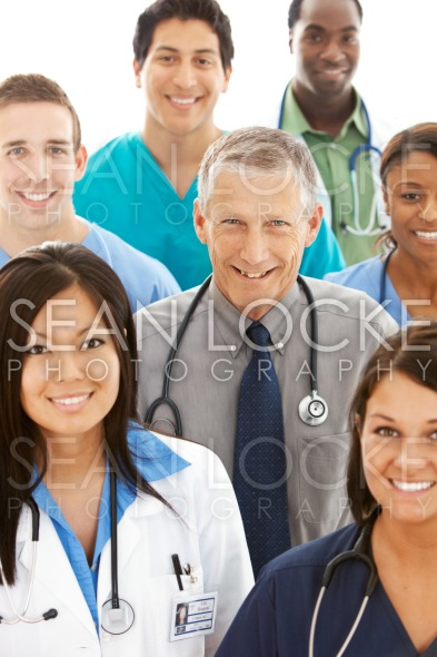 Doctors: Mature Doctor in Center of Physician Group Stock Photography Content by Sean Locke