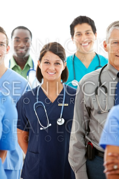Doctors: Female Doctor with Group of Medical Professionals Stock Photography Content by Sean Locke