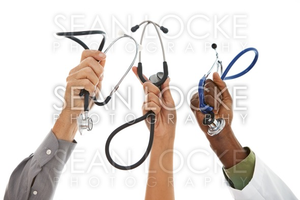 Doctors: Hands in the Air with Stethoscopes Stock Photography Content by Sean Locke