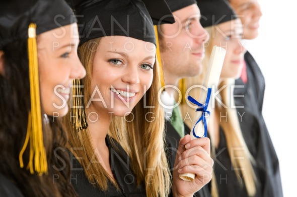 Graduation: Proud Girl Graduate Looks Out From Line Stock Photography Content by Sean Locke