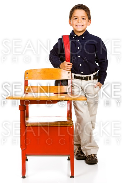 Student: Hispanic Student Stands By Desk Stock Photography Content by Sean Locke
