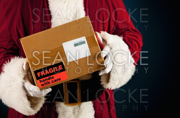 Santa: Getting Ready to Ship Package Stock Photography Content by Sean Locke
