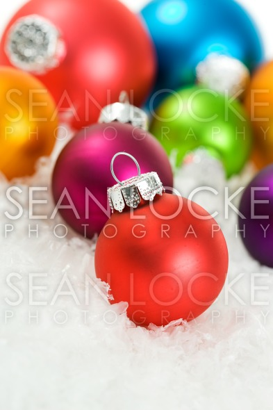 Christmas: Christmas Tree Ornaments In Snow Stock Photography Content by Sean Locke