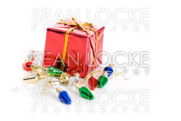 Christmas: Tiny Present And Light Decorations Stock Photography Content by Sean Locke