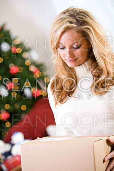 Christmas: Woman Gets Gift In Mail Stock Photography Content by Sean Locke