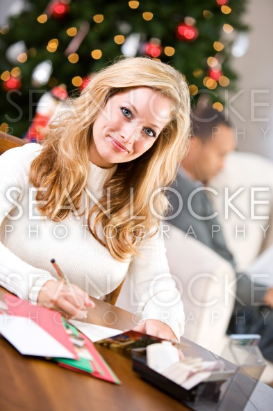 Christmas: Woman Writing Christmas Cards Stock Photography Content by Sean Locke