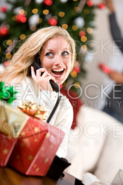 Christmas: Woman Talking On Telephone Stock Photography Content by Sean Locke