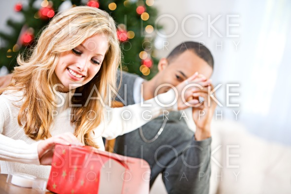 Christmas: Woman Trying To Wrap Present Stock Photography Content by Sean Locke
