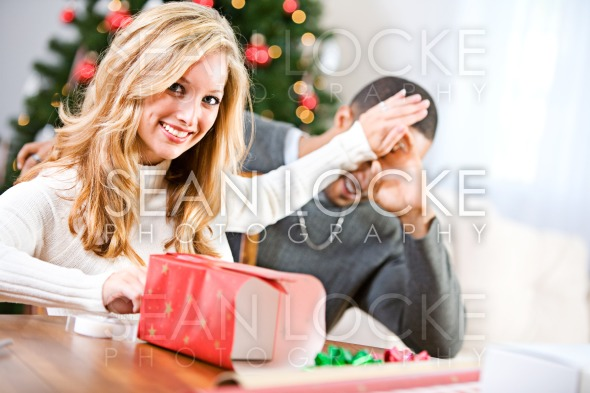 Christmas: Husband Wants To See Christmas Gift Stock Photography Content by Sean Locke