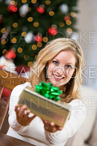 Christmas: Pretty Woman Getting Gift Ready Stock Photography Content by Sean Locke