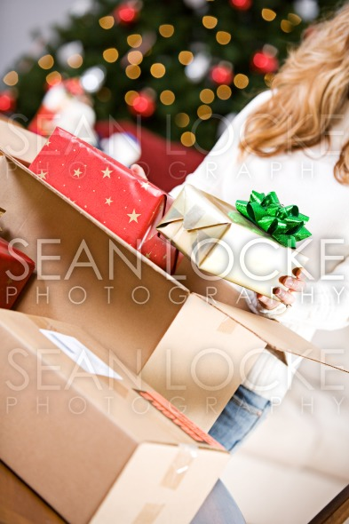 Christmas: Putting Wrapped Gifts In Box Stock Photography Content by Sean Locke