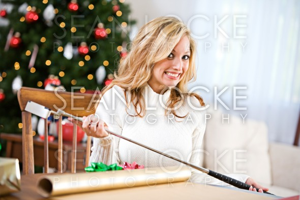 Christmas: Not Sure How To Wrap Golf Club Stock Photography Content by Sean Locke