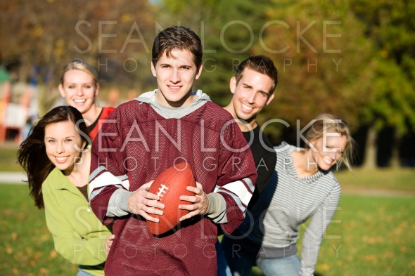 Football: Football Friends Together in Park Stock Photography Content by Sean Locke