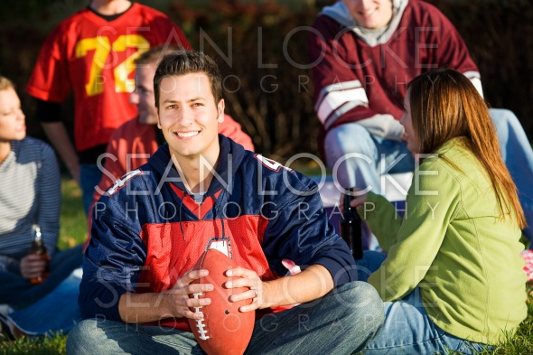 Football: Football Guy with Friends at Picnic Stock Photography Content by Sean Locke