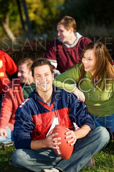 Football: Relaxing with Friends in Park Stock Photography Content by Sean Locke