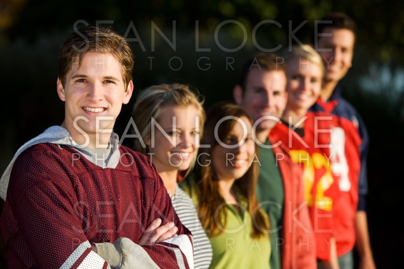 Football: Friends Ready to Play Football in Park Stock Photography Content by Sean Locke