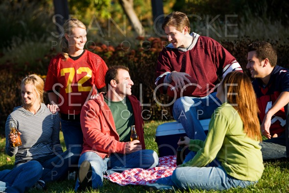Football: Group of Friends Having Picnic in Park Stock Photography Content by Sean Locke