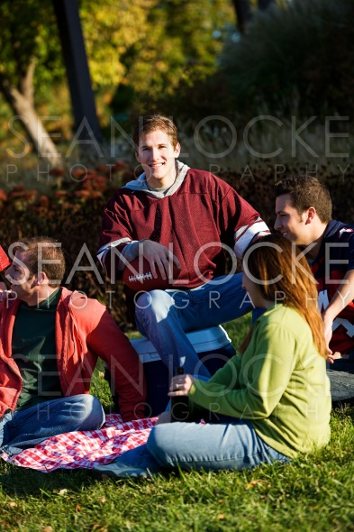 Football: Cheerful Guy with Friends Stock Photography Content by Sean Locke