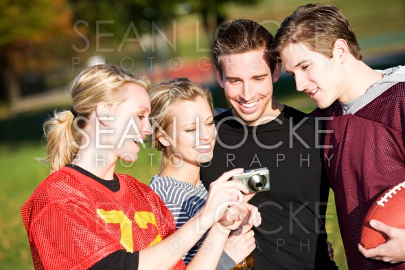 Football: Friends Look at Funny Image on Camera Stock Photography Content by Sean Locke