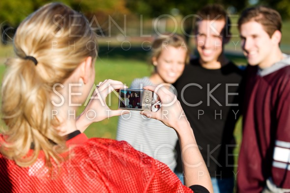 Football: Girl Takes Photo of Friends Stock Photography Content by Sean Locke
