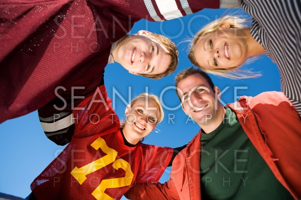 Football: Group of Friends Huddle Up Stock Photography Content by Sean Locke