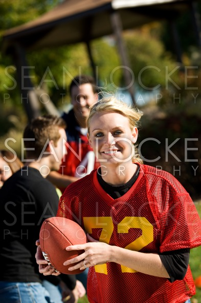 Football: Woman Running With Ball Stock Photography Content by Sean Locke