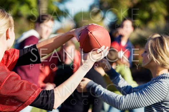 Football: Woman Catches Football Stock Photography Content by Sean Locke