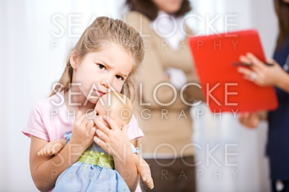 Nurse: Parent Talks to Doctor With Child Unsure Stock Photography Content by Sean Locke