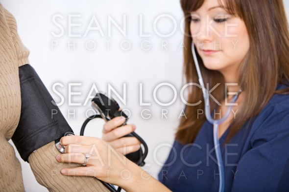 Nurse: Checking the Blood Pressure of Patient Stock Photography Content by Sean Locke